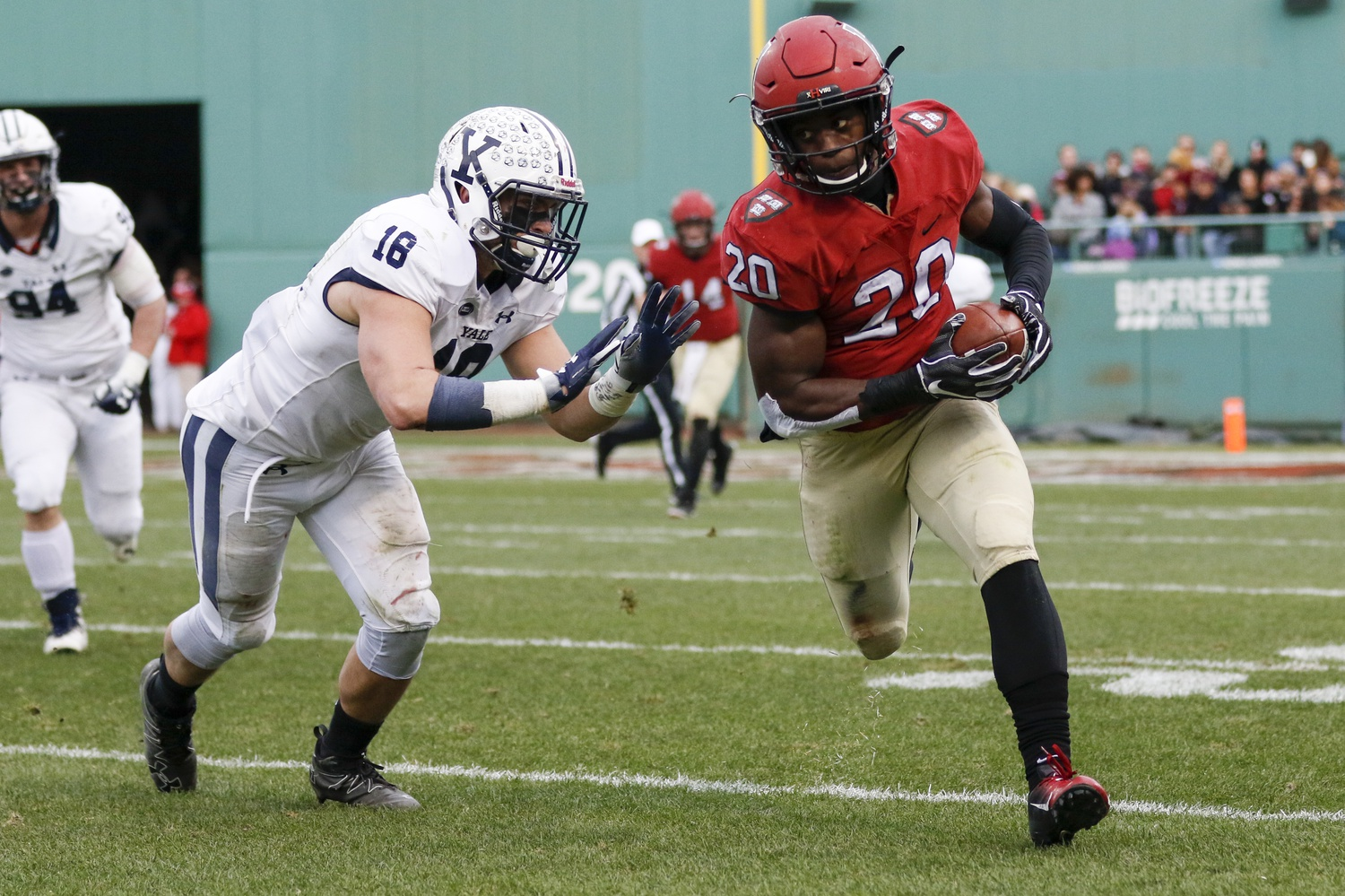 Junior running back Aaron Shampklin, Saturday's leading rusher with 183 yards and two touchdowns, rushes in 2018's Harvard-Yale game at Fenway Park.
