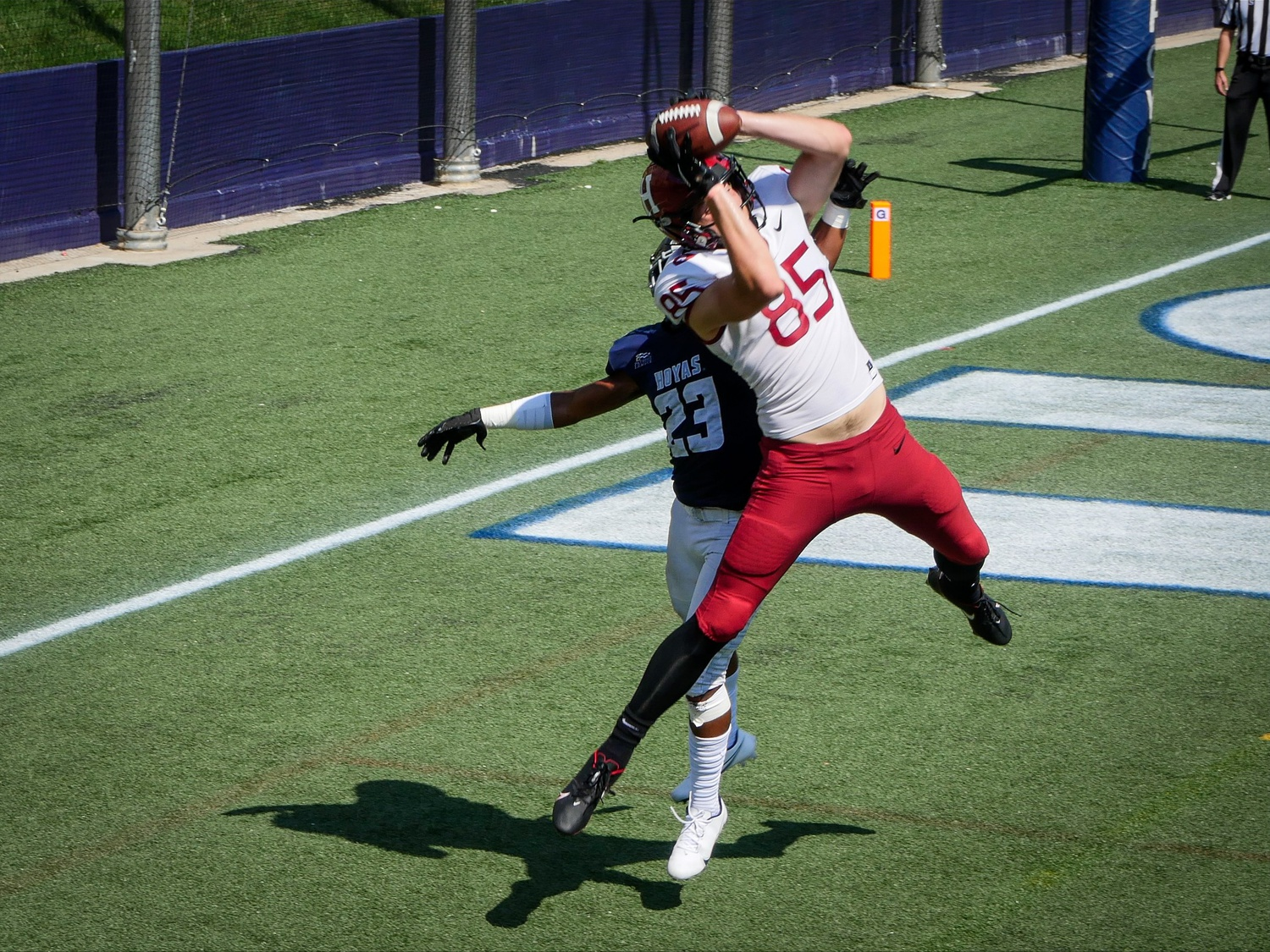 Senior tight end Adam West skies above the Hoyas defender to pull down a touchdown grab, giving the Crimson a 37-9 lead en route to a 44-9 final score.
