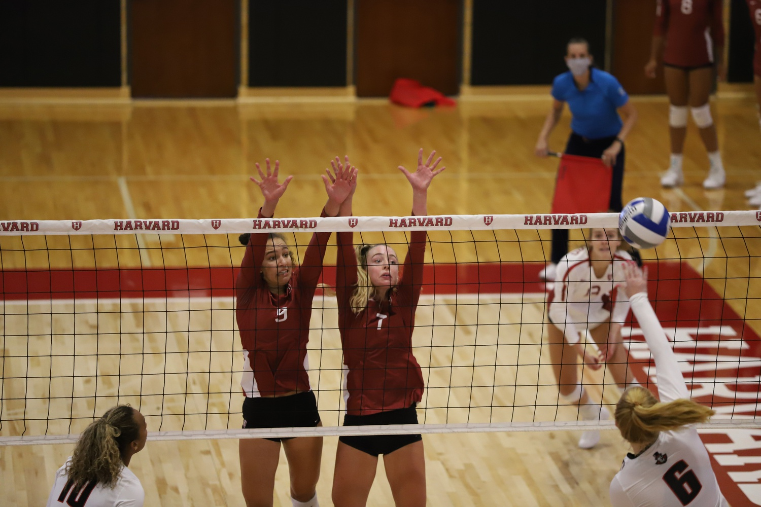 First-year outside hitter Corinne Furey (right) registered eight kills in women's volleyball's narrow victory over American University.