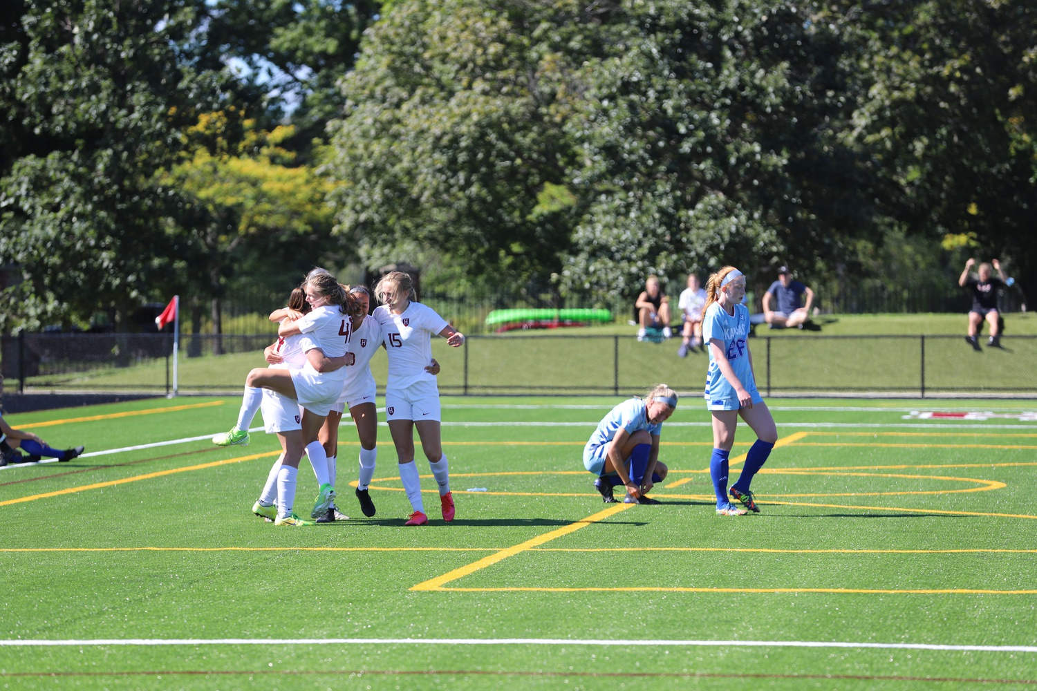 The Crimson squad celebrates a goal in last weekend's 2-1 win over the Kansas Jayhawks.