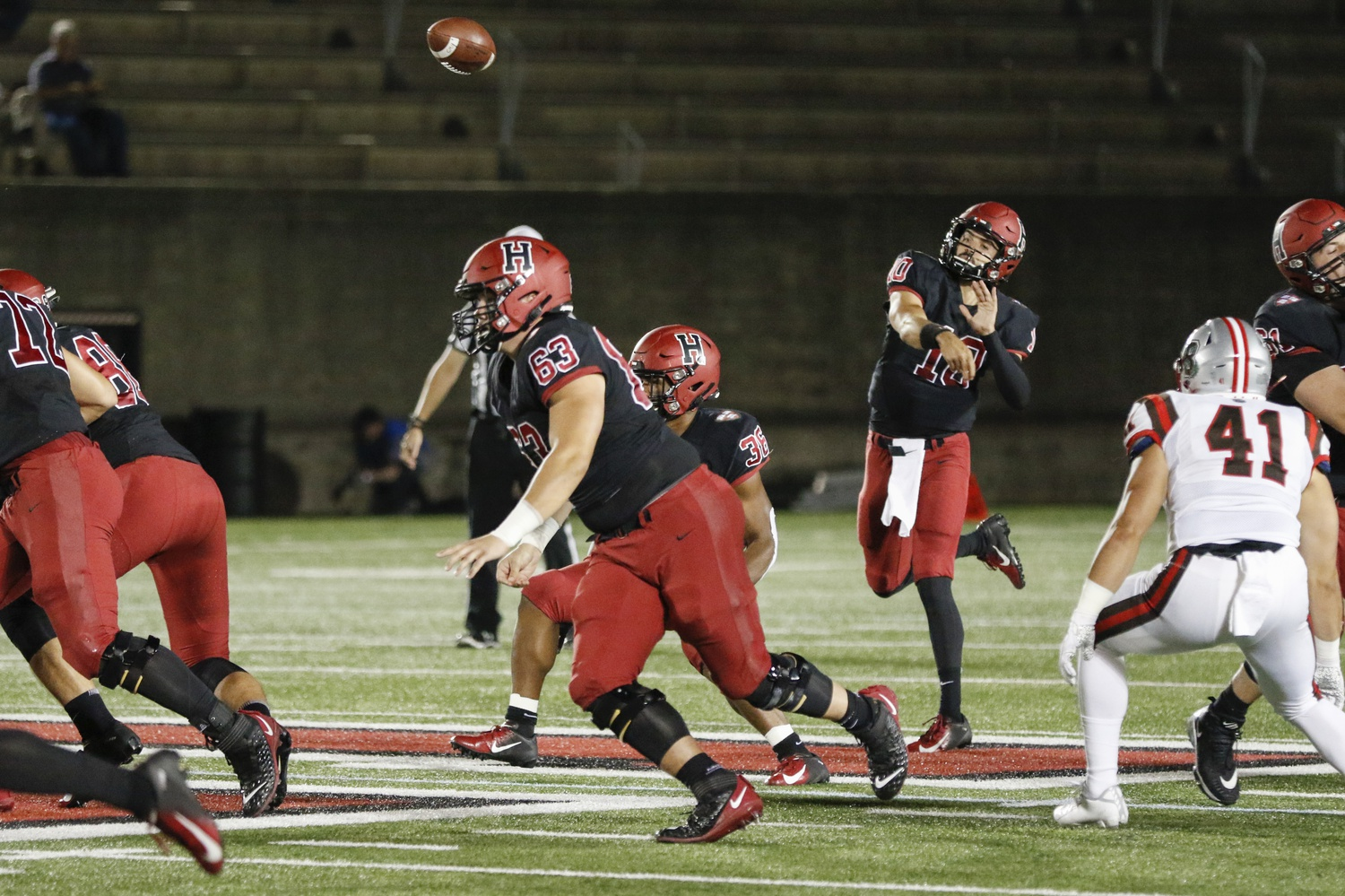 Senior quarterback Jake Smith drives the ball downfield in Harvard's last home opener, also against Brown, a 42-7 victory.