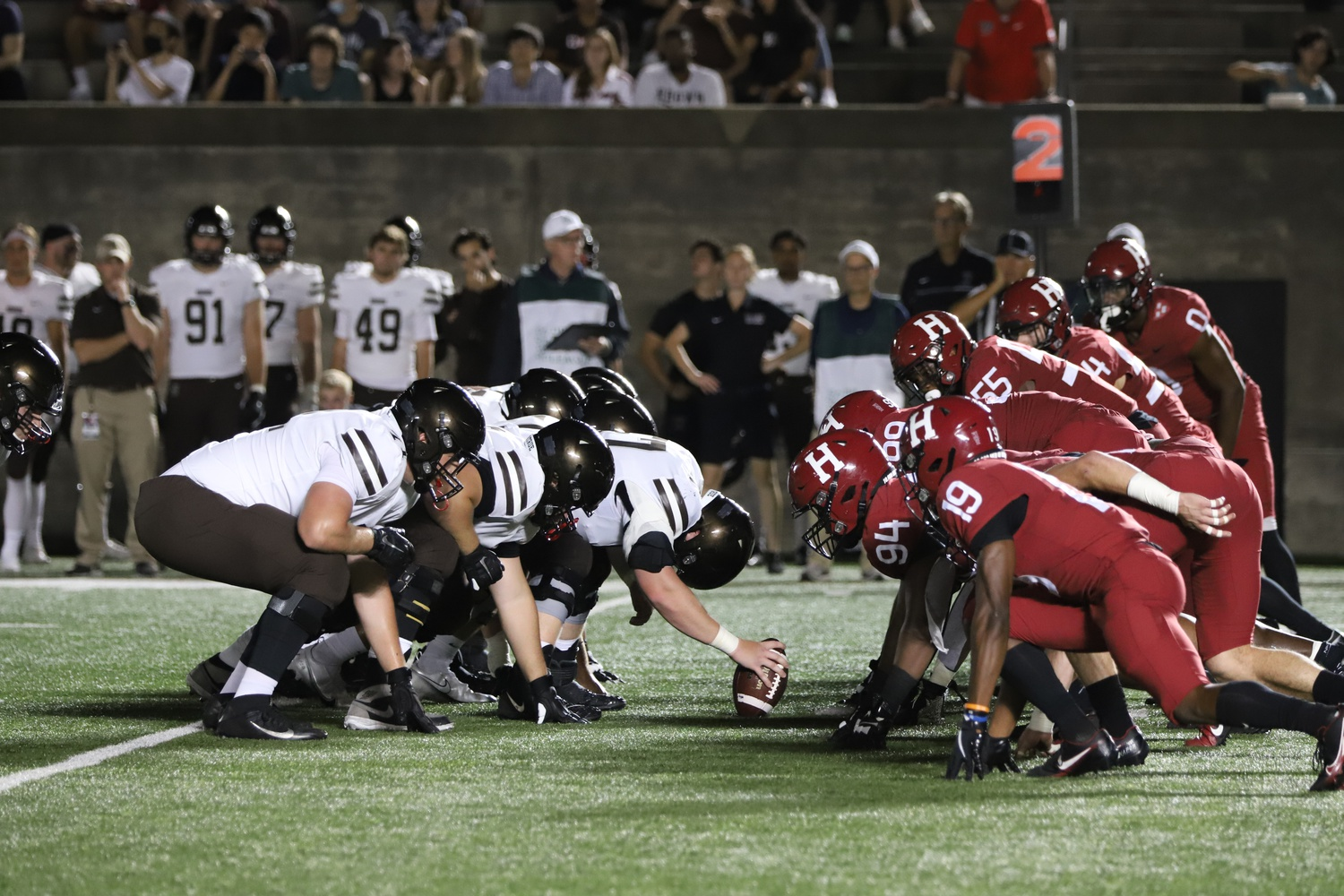 The Crimson and Bears line up for a second-down snap in front of a packed house at Harvard Stadium. The Harvard defense would pitch a shutout in the first half en route to a 49-17 victory.