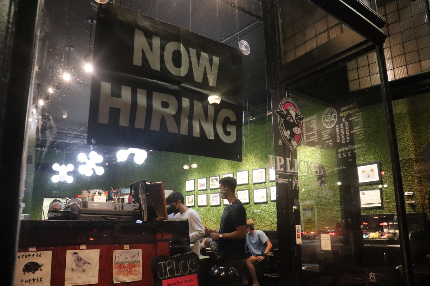 A sign announcing job openings is displayed on the window of J.P. Licks, an ice cream shop in Harvard Square, amid a national shortage of restaurant workers.