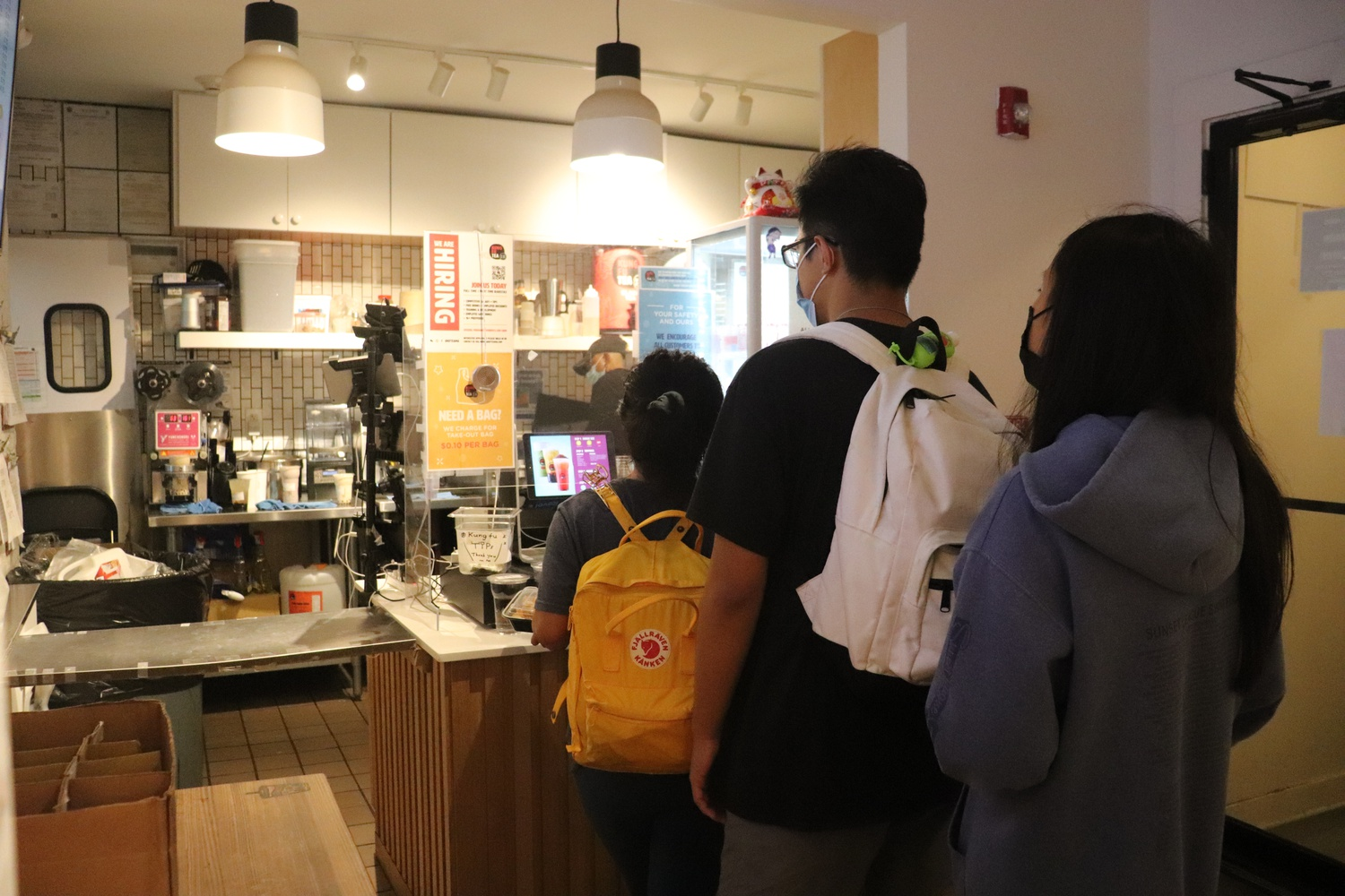 Patrons line up inside Kung Fu Tea, a store on Massachusetts Avenue, a frequent sight amid a national shortage in restaurant workers.
