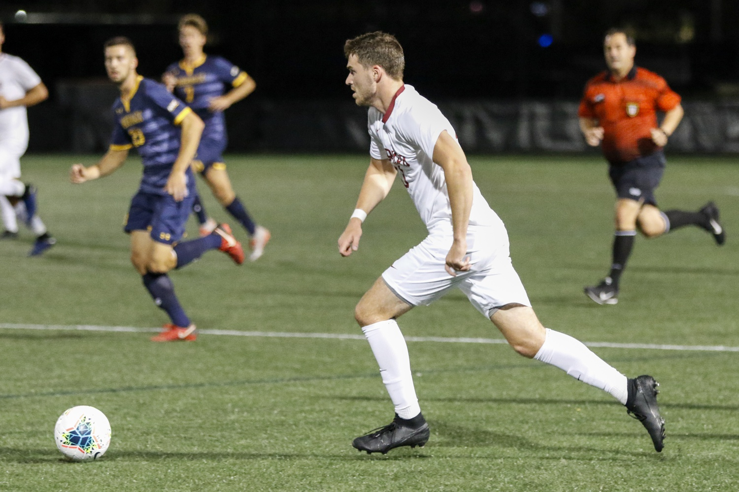 Junior forward Duncan Sutherland, pictured above in 2019, was instrumental in helping set up the Crimson's first goal in its 2-1 OT victory over the Catamounts.