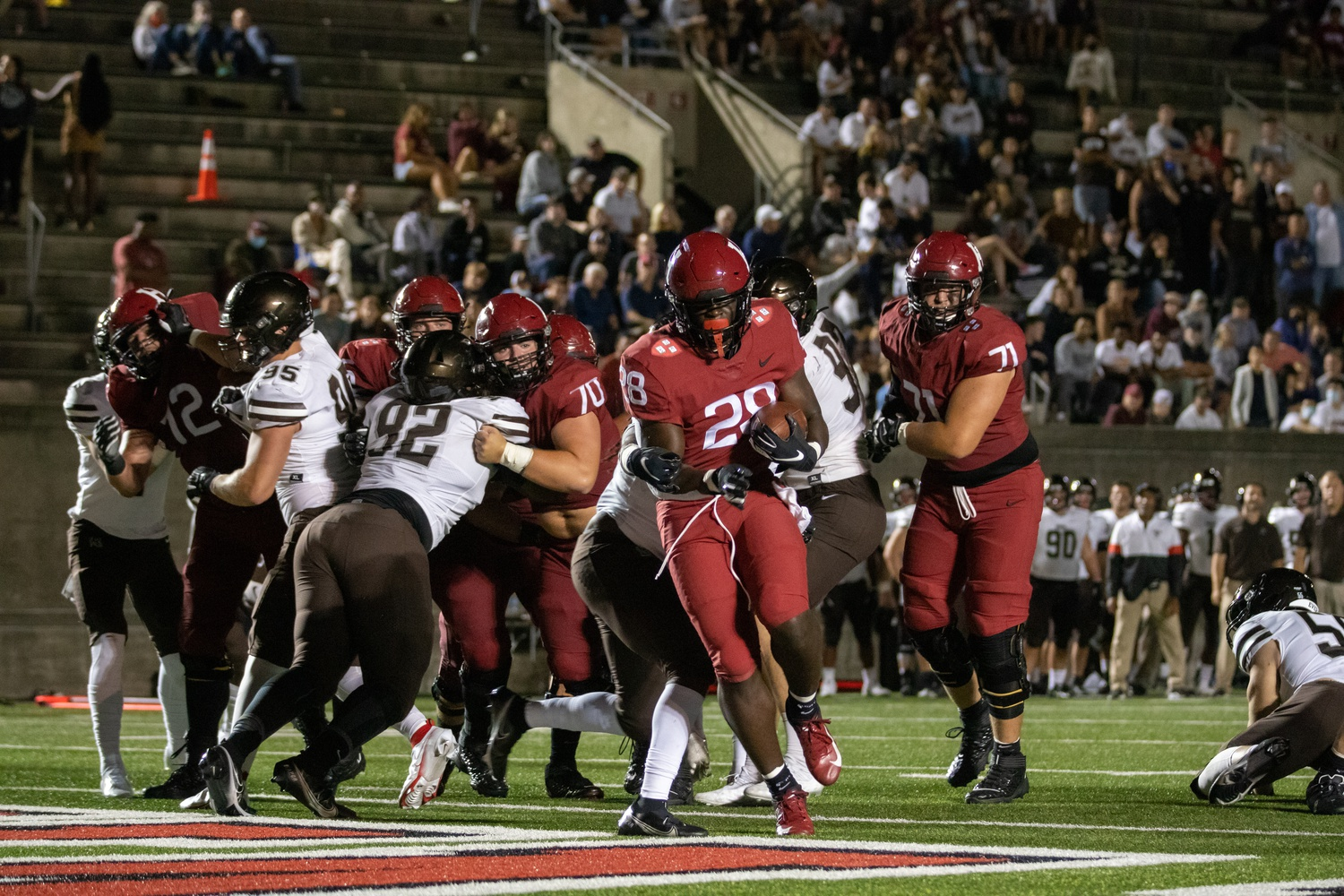 Sophomore running back Sone Ntoh punches in one of his two touchdowns on the night, which would go along with 30 yards rushing on nine carries.