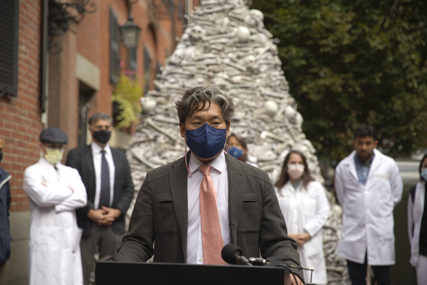 KJ Seung, an assistant professor at Harvard Medical School, speaks at a Wednesday rally during which a group of HMS-affiliated doctors called for global vaccine equity outside the home of Moderna's CEO.
