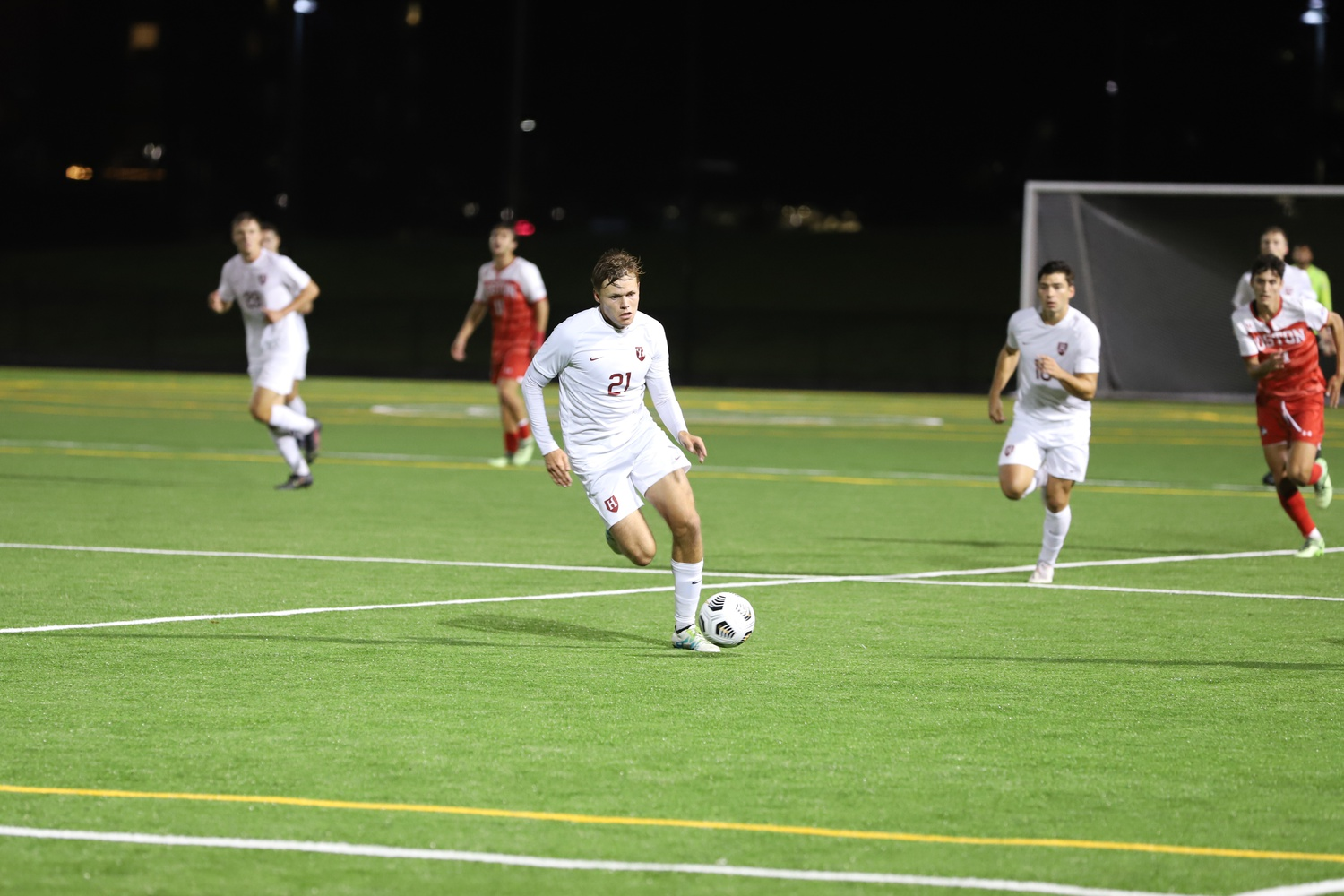 Sophomore midfielder Willem Ebbinge leads the attack, netting his third assist of the season on the way to a 2-1 victory for Harvard.