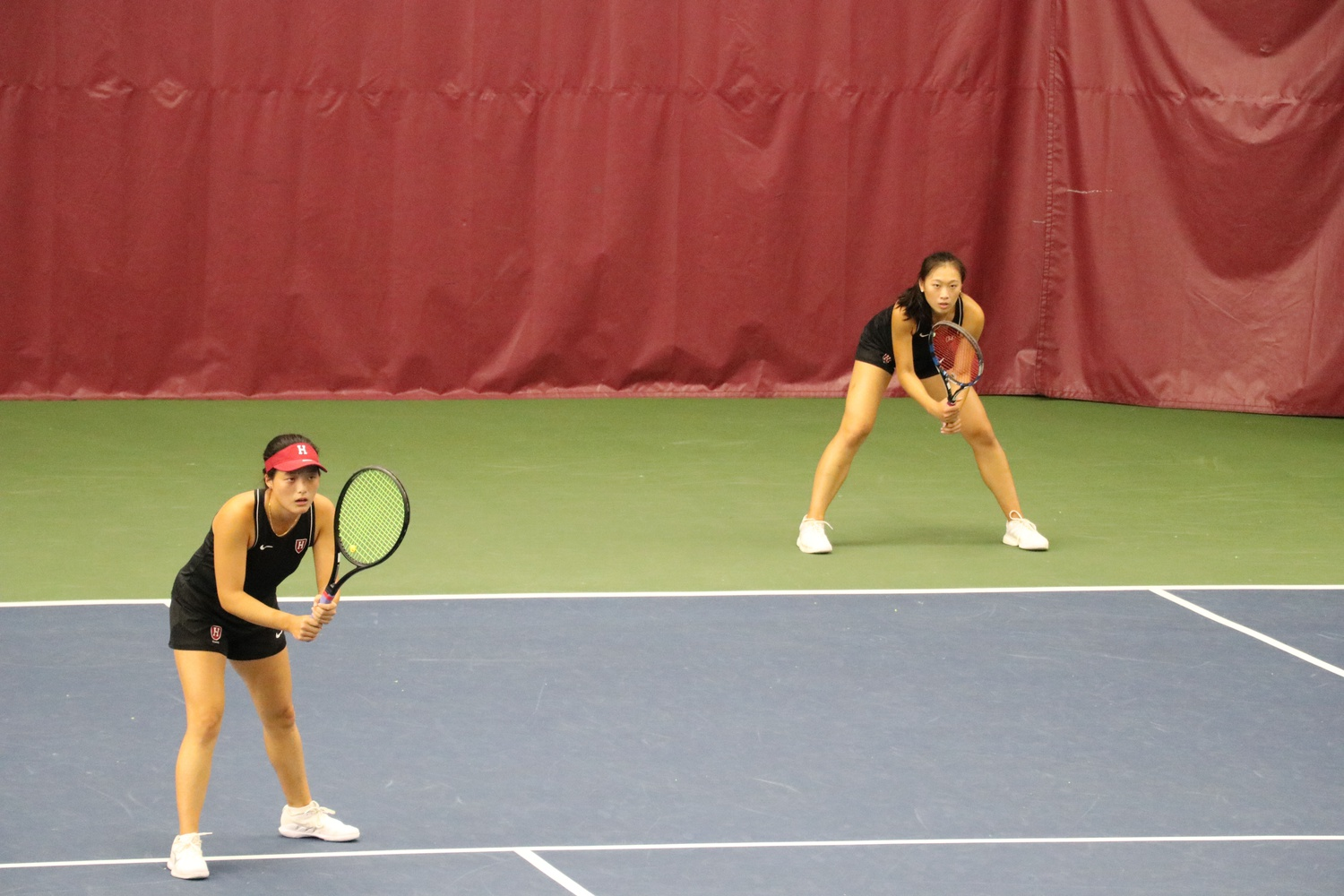 First-year Angel You and senior Rachel Lim team up in doubles against Boston University.