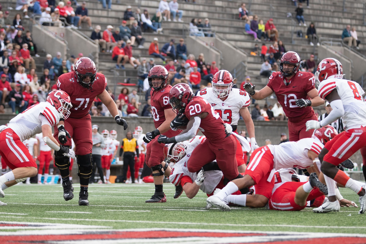 Junior running back Aaron Shampklin bursts through a line of Cornell defenders as he sets his sights on the goal line.