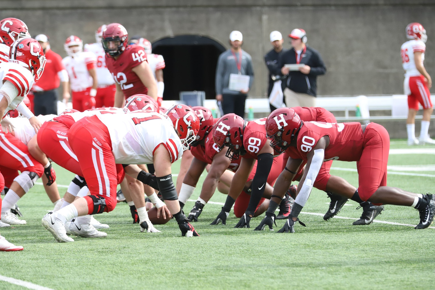 The Harvard defensive line, led by junior Truman Jones, gears up for a confrontation with Big Red offensive line in Saturday's matchup.