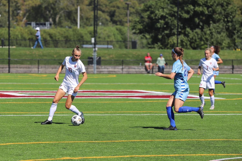 Junior center forward Angela Caloia (#10) led the scoring charge for the Crimson against Cornell, netting two of Harvard's four goals.