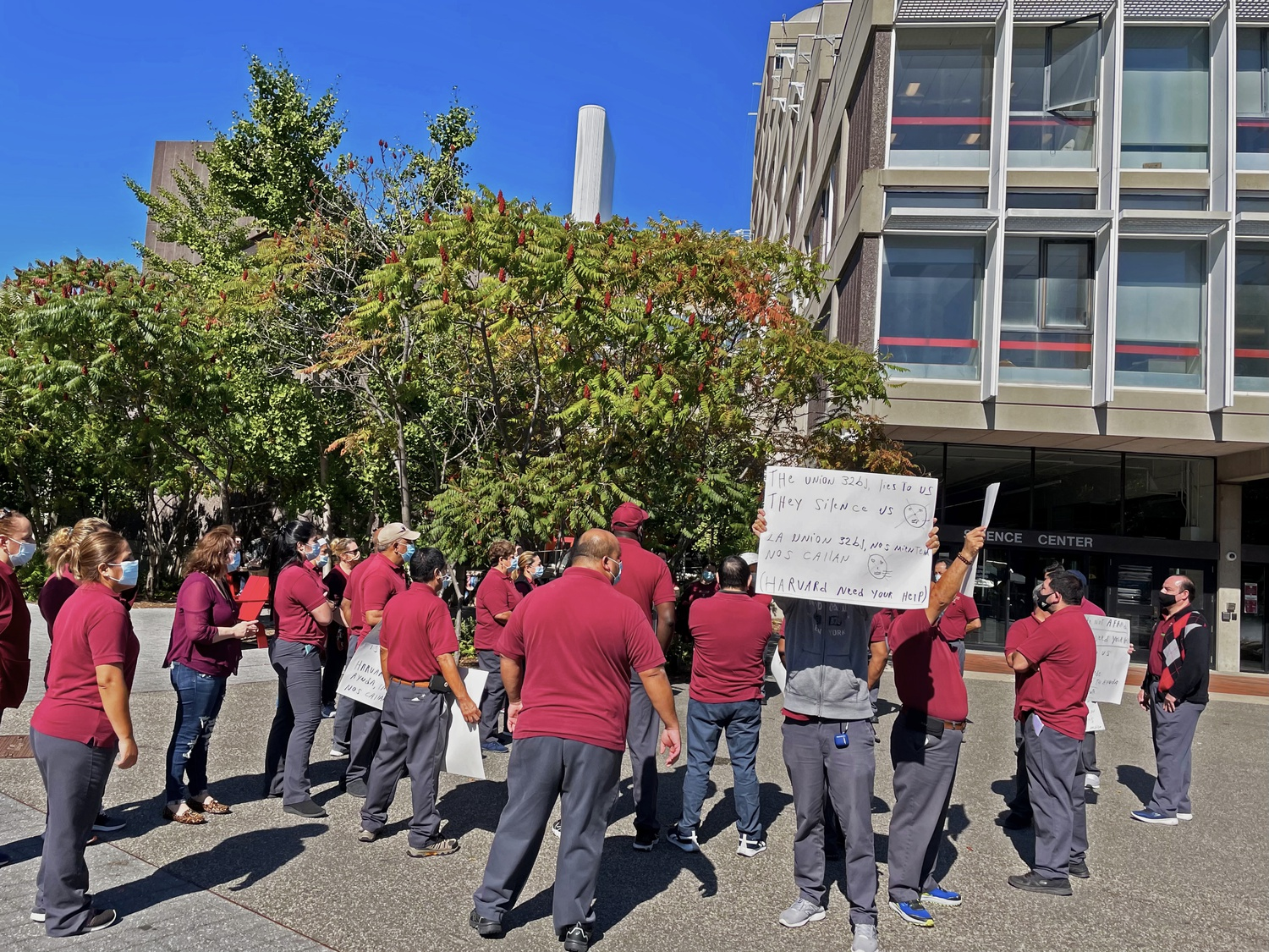Approximately 25 Harvard custodians rallied in Science Center Plaza Friday, asking the University to postpone the opening of negotiations with their union until intraunion conflicts are resolved.