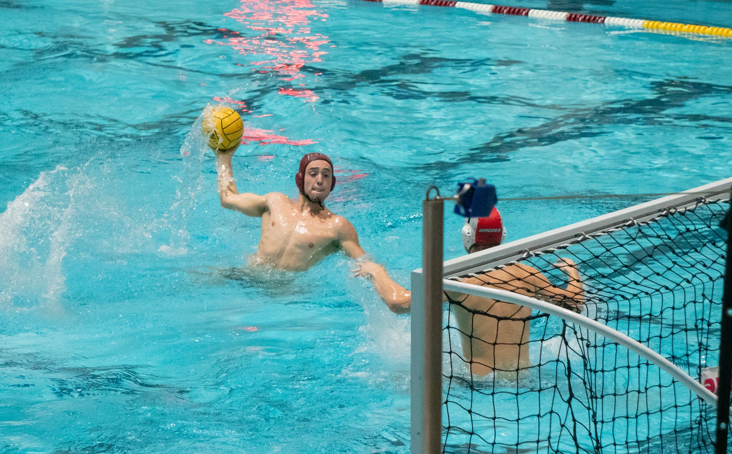 Junior attacker Alex Tsotadze launches a shot in last week's matchup with Wagner College, a contest in which he scored three goals. Tsotadze tallied four goals in Sunday's 16-10 victory over its neighboring university, MIT, which bumped the team's record to 13-2.