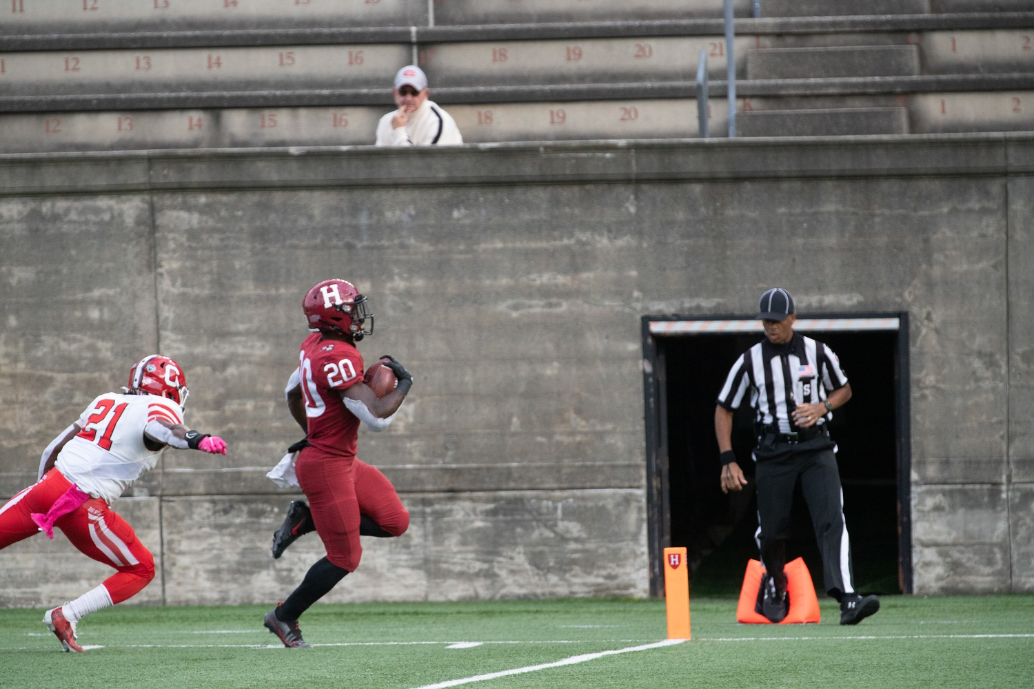 Junior running back Aaron Shampklin races past a Cornell defender for the touchdown in last Saturday's 24-10 victory. Shampklin finished the contest with two scores and 92 yards on 18 carries, adding to his impressive season as the Crimson's workhorse from the backfield.