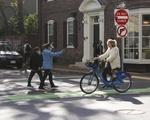 Students Ride Blue Bikes
