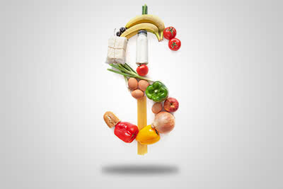 A dollar sign made of fruits and vegetables