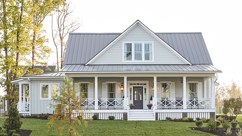 Modern farmhouse designs house plans southern living for Farmhouse building plans photos