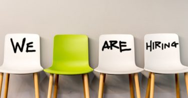 chairs that have we are hiring spelled out