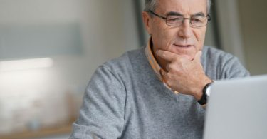 retiree applying to Costco on computer