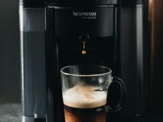 nespresso machine brewing coffee