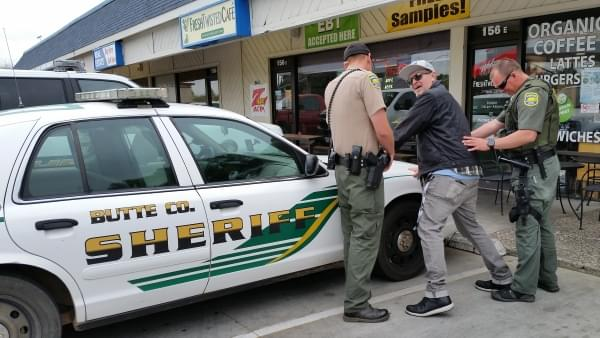 Tim Buc Moore getting frisked by police at Wake the Buc Up in North Chico at Fresh Twisted Cafe