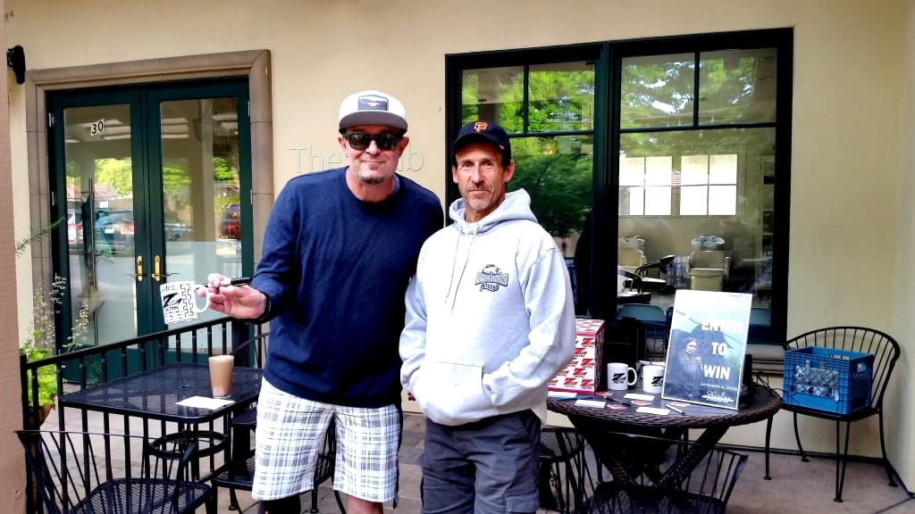 Tim Buc Moore with a listener at 106.7 Z-Rock's Wake the Buc Up live broadcast 4/25/18 at Bidwell Perk in Chico