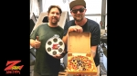 Tim Buc Moore with Mad Dash Pizza Z-Rock Munch Box winner Steve Szwarc at PBM Supply and Manufacturing in Chico