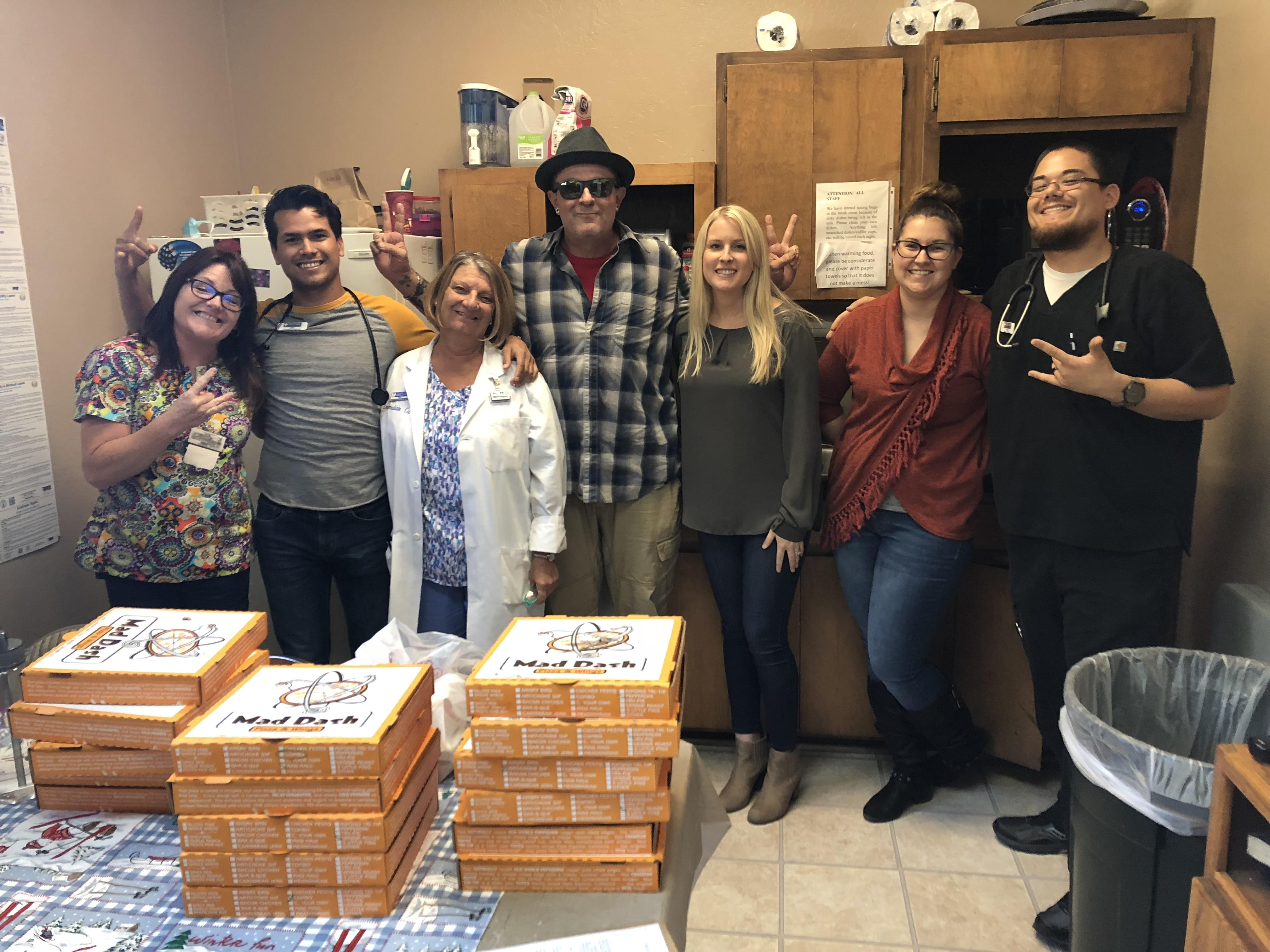 Tim Buc Moore with winner and crew at Valley Clinical Lab inside Immediate Care in Chico for the Z-Rock Munch Box