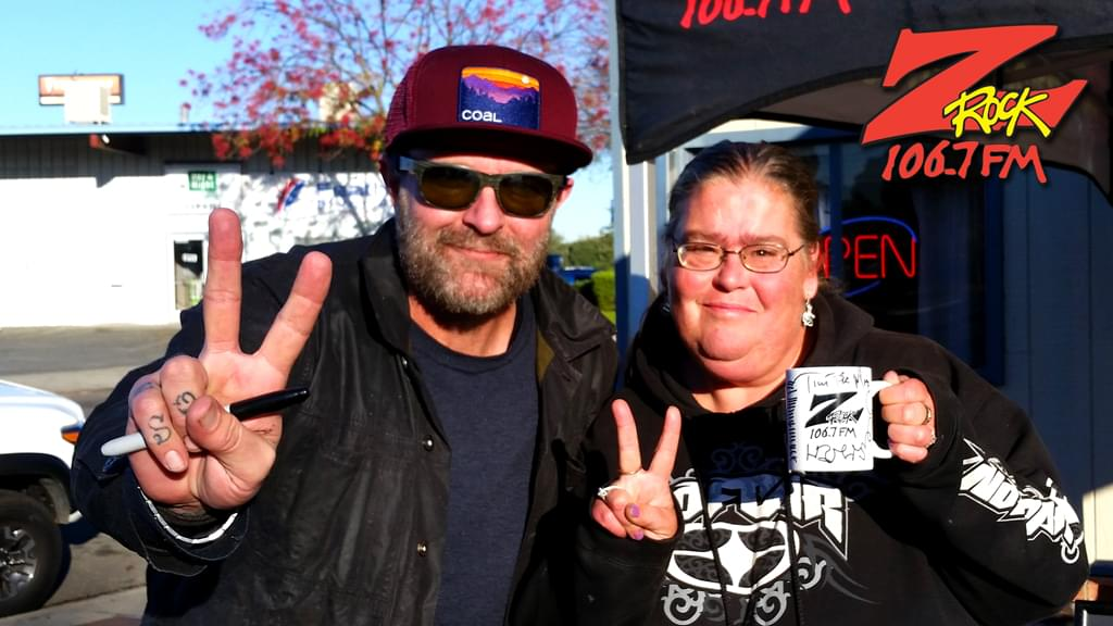 Tim Buc Moore with a listener at Wake the Buc Up in Oroville at Lots 'A Java Thursday December 6th 2018