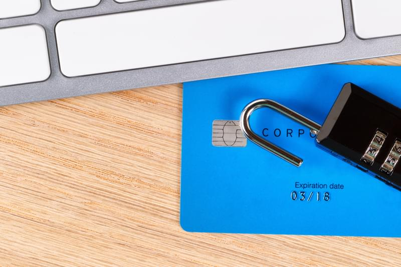Credit cards with open lock on desktop