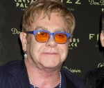 Elton John defends Prince Harry and Meghan Markle's vacation
