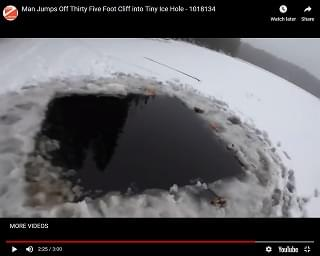 Viral Video of the Day: Man Jumps Off 35-Foot Cliff into Little Ice Hole