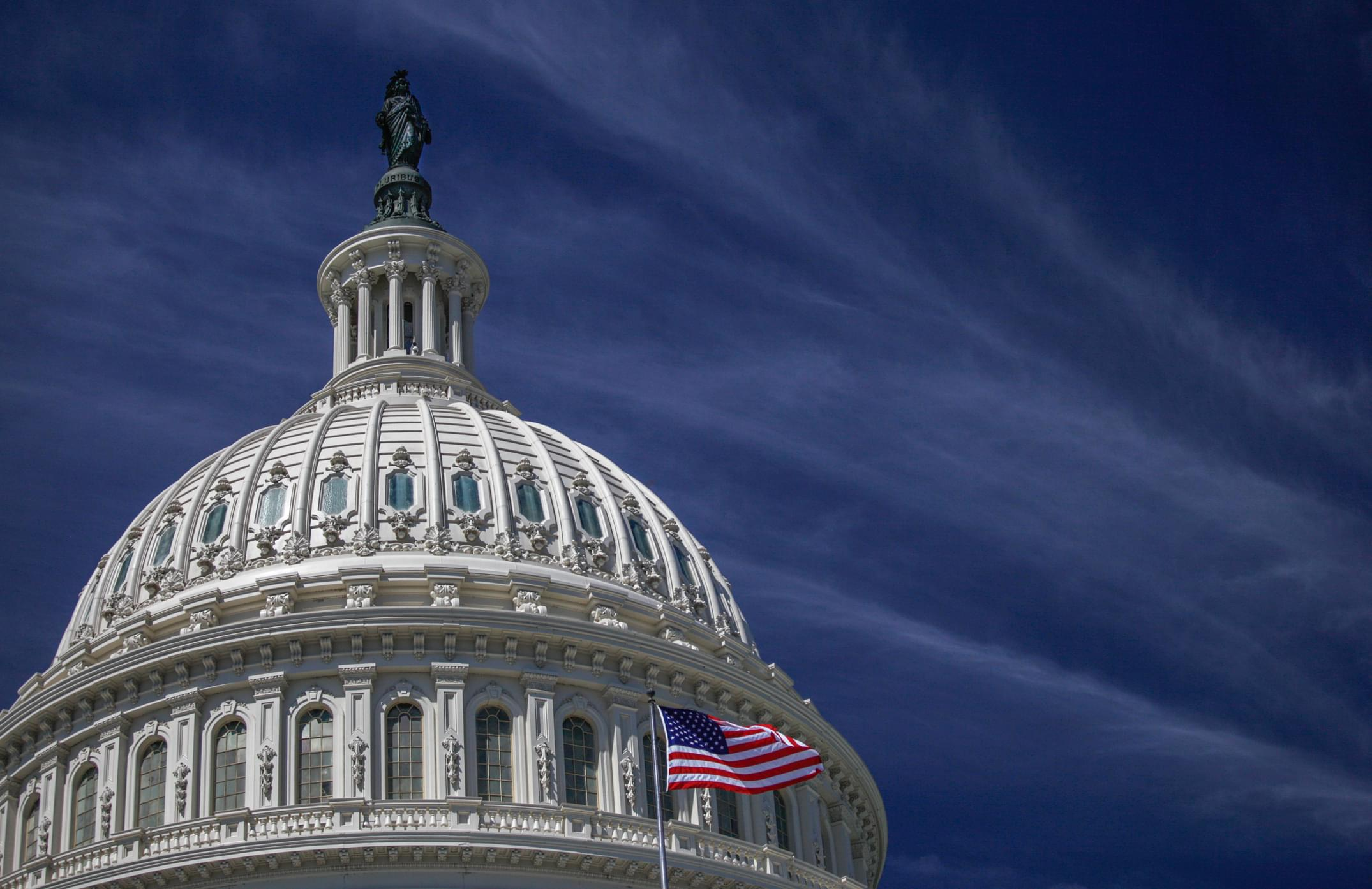 U.S. Capitol Building Dome and American Flag in Washington, DC