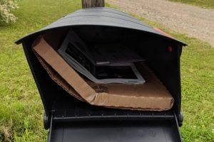 Snapped in half package shoved into mailbox with Vinyl Record inside