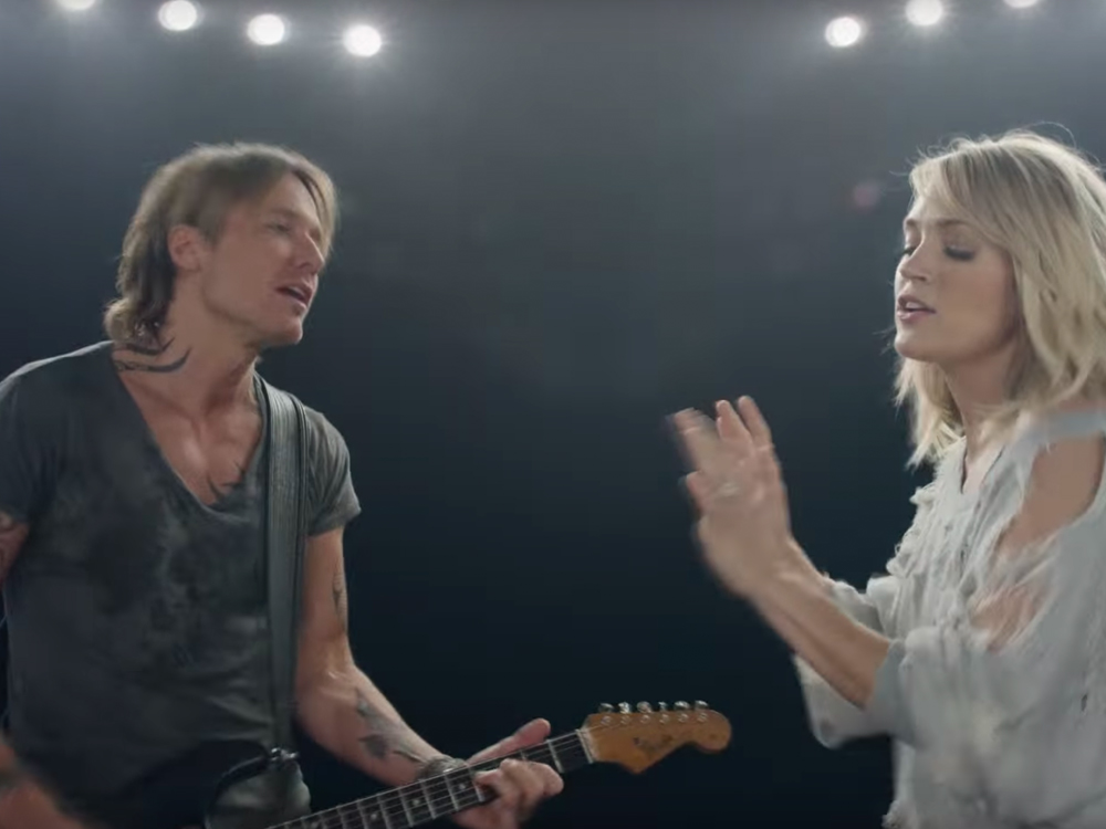 "Watch [While You Can] Keith Urban & Carrie Underwood Bust a Move in New Video for ""The Fighter"""