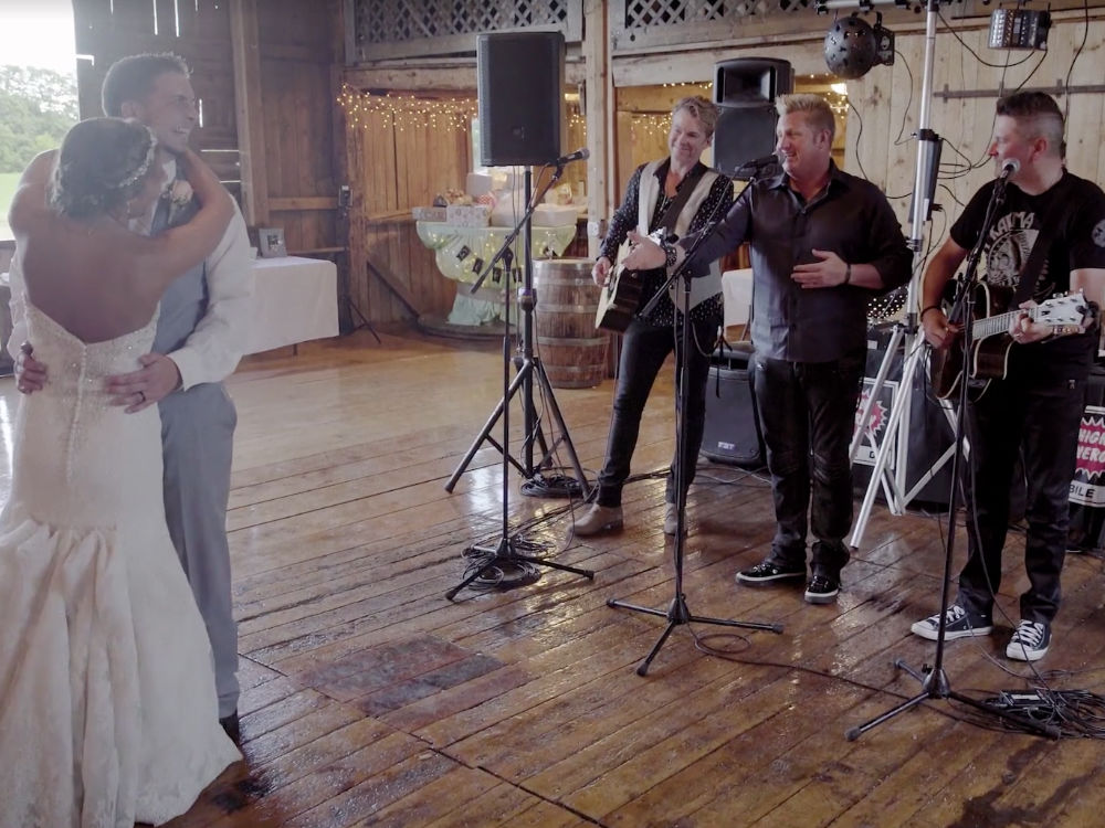 """Watch Rascal Flatts Surprise Wedding Couple With First Dance Performance of """"God Bless the Broken Road"""""""