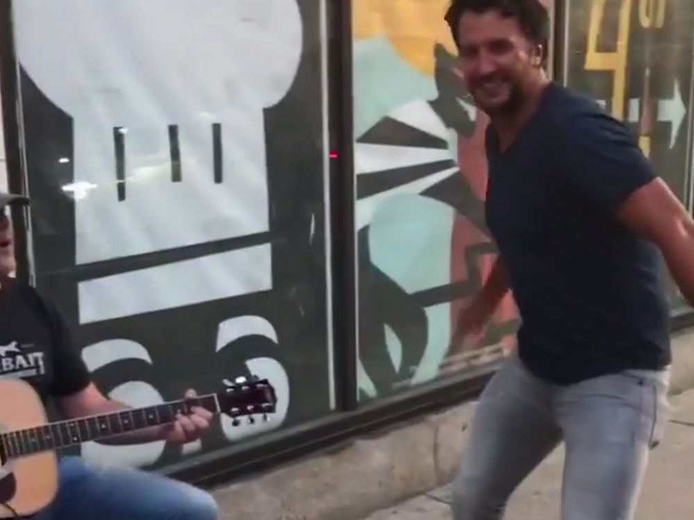 Watch Luke Bryan Dance a Jig as Rhett Akins Busks on the Streets of Cleveland