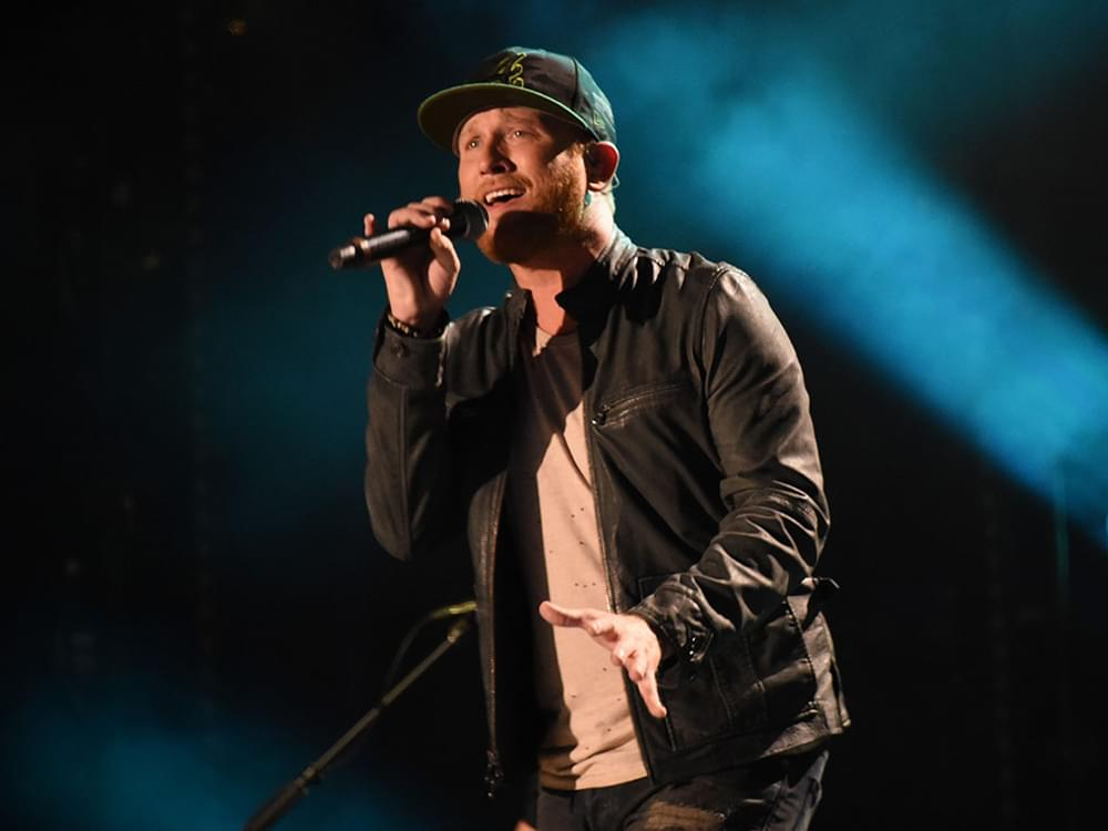 "Listen to Cole Swindell's Guilt-Ridden New Single, ""Love You Too Late"""