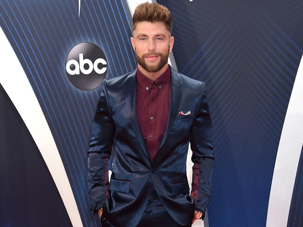 """Chris Lane Says His Top 5 Single, """"I Don't Know About You"""" Has an Alias: """"Wrist Tattoo Bible Verse Song"""""""
