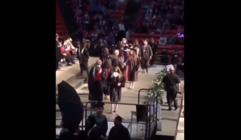 VIDEO: Guy Attempts Backflip At Graduation