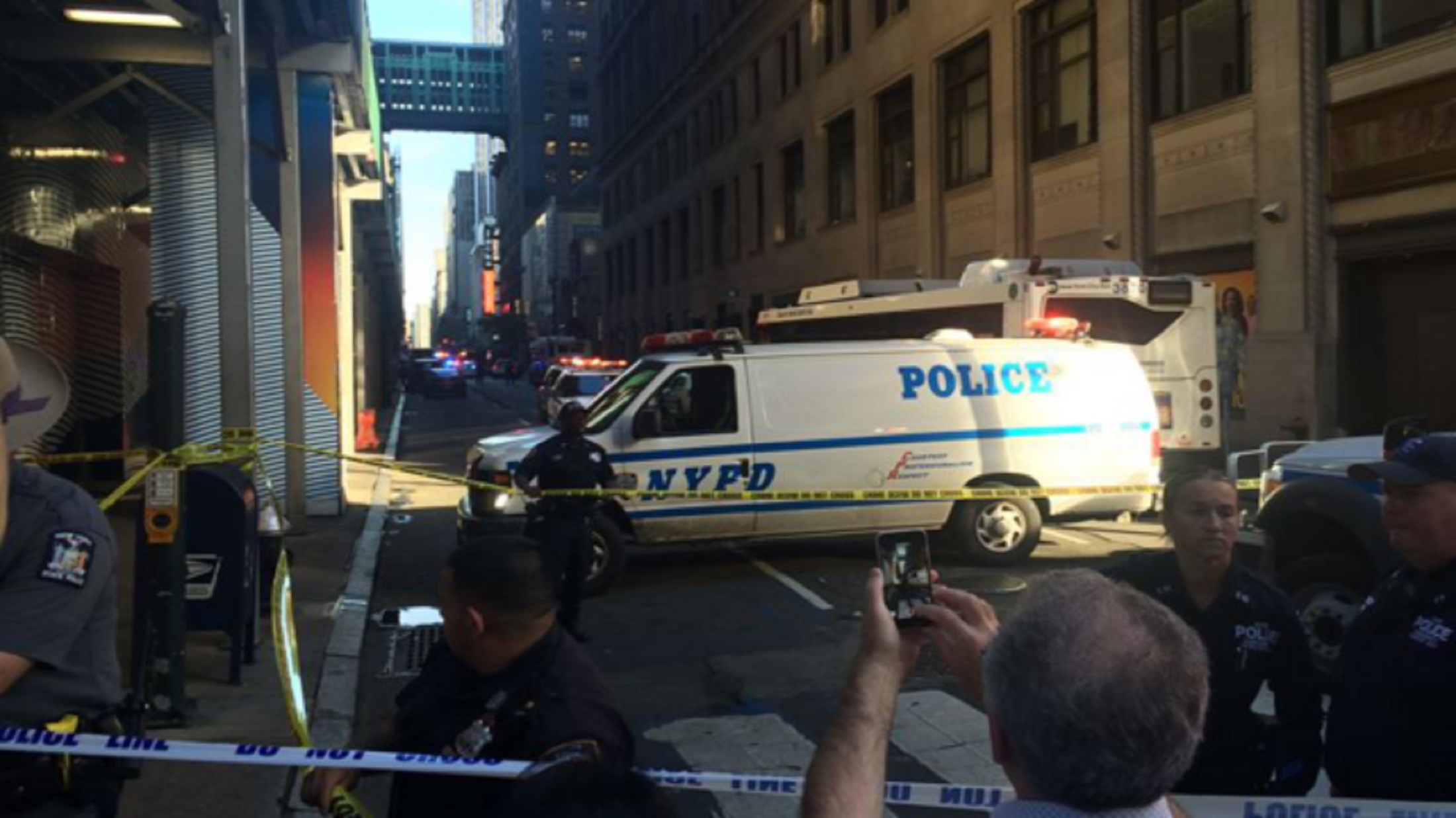 Suspect Shot in Midtown After Attack on NYPD Officer with Meat Cleaver