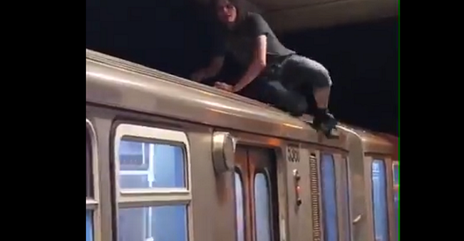 Video: Guy jumps on top of the CTA Red Line and takes it for a ride