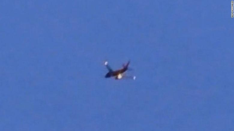 Watch plane engine catch fire in-flight