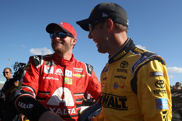 HOMESTEAD, FL - NOVEMBER 19:  Dale Earnhardt Jr., driver of the #88 AXALTA Chevrolet, and Matt Kenseth, driver of the #20 DeWalt Hurricane Relief Toyota, take part in pre-race ceremonies for the Monster Energy NASCAR Cup Series Championship Ford EcoBoost 400 at Homestead-Miami Speedway on November 19, 2017 in Homestead, Florida.  (Photo courtesy of NASCARmedia.com/Monster Energy NASCAR Cup Series Championship Ford EcoBoost 400by Chris Graythen/Getty Images)