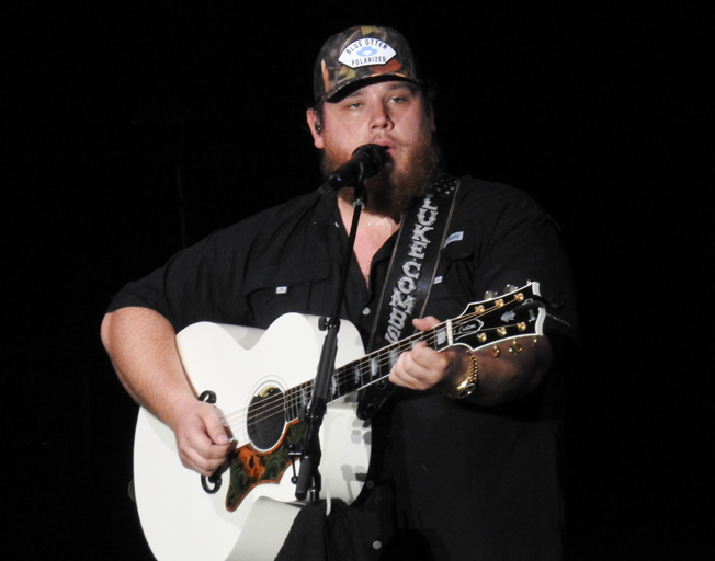Luke Combs on stage at Grossinger Motors Arena in Bloomington, IL