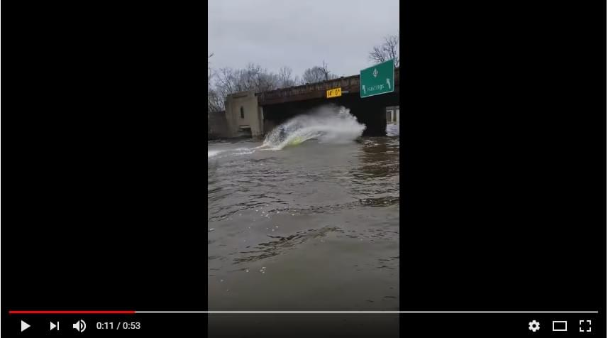 Jet Skiers On A Flooded Kalamazoo Street