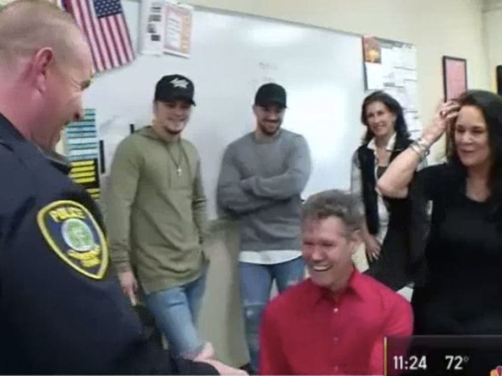 Watch Randy Travis Surprise a Texas Police Officer With a New Gibson Guitar for Christmas