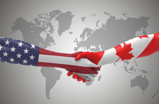 American and Canadian Hands Shaking