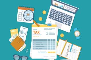 Tax return with laptop glasses calendar